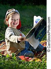 The kid studies to read