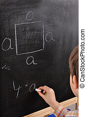 The perimeter of a square- student by the blackboard
