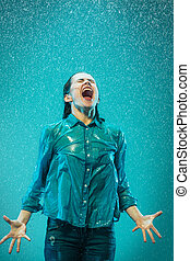 portrait of young beautiful woman in the rain