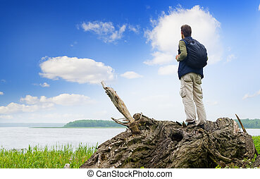 The tourist looking in a distance on the lake