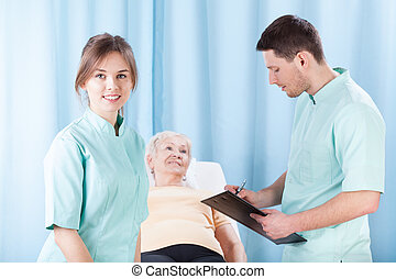 Therapists doing medical examination