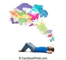 Lying boy think creative with colorful splash