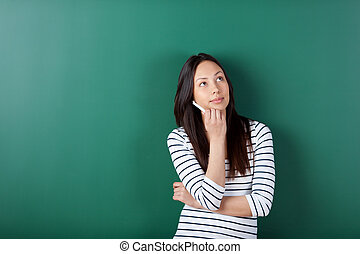 thoughtful female student looking up