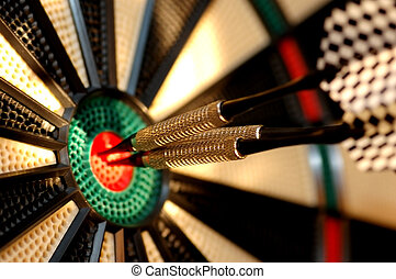 Three arrows in the centre of a dart board. Shallow depth of field