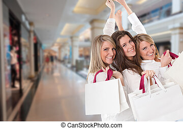 Three happy shoppers