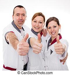 three nurses demonstrate teamwork and success