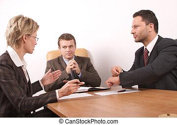 three people meeting