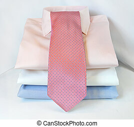 Three formal shirts and modern pink tie