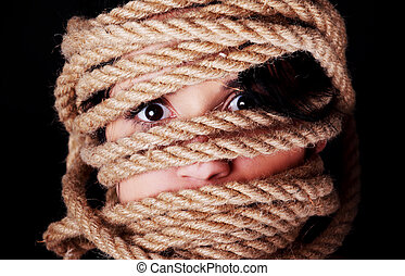 Tied up scared woman face. Violence concept.