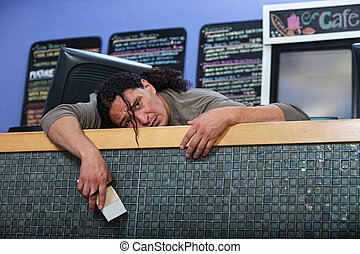 Tired Native American restaurant owner at counter