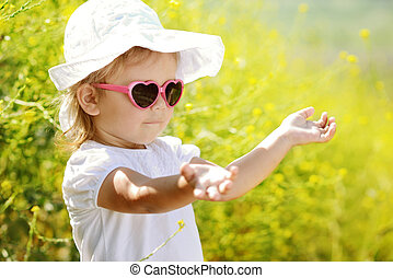 toddler girl enjoying summer light