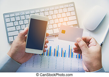 Top view Credit Card Holders Used Laptops and smartphone Ordering and Payment - Concepts of Using Technology in Business