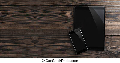 Top view of digital tablet and mobile phone on brown desk. Modern devices, copy space