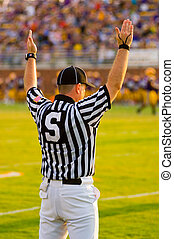A Football Official signaling football and a game of American Football