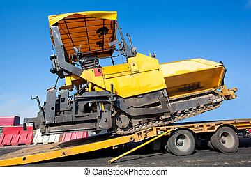 Transportation tracked paver machine during roadworks for asphalt paving