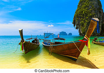 Travel landscape, beach with blue water and sky at summer. Thailand nature beautiful island and traditional wooden boat. Scenery tropical paradise resort.