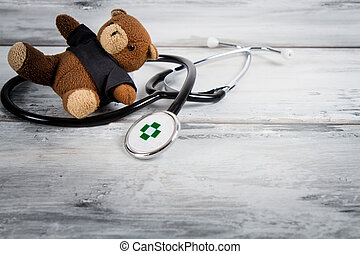 stethoscope and teddy bear