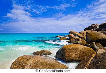 Tropical beach at island Praslin, Seychelles - vacation background