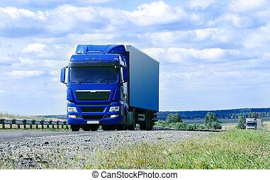 two big trucks move on highway