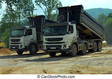 two big trucks tipper at work