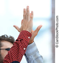 two colleagues giving each other high-five