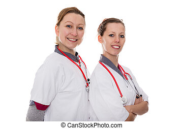 two female doctors smiling to the viewer