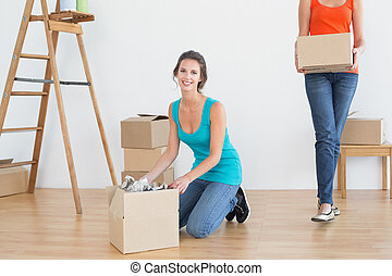 Two friends moving together in a new house