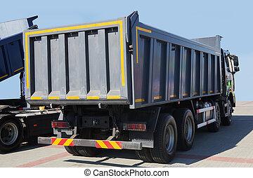 Two large new dump trucks
