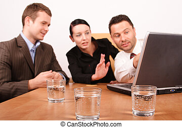 two men and woman working on project with laptop