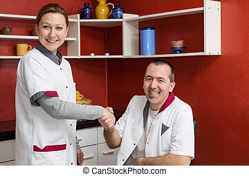 two nurses giving each other the hand