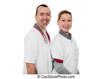 two nurses smiling to the viewer