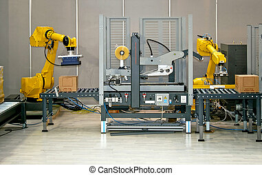 Two robotic hands simultaneous work at packaging line