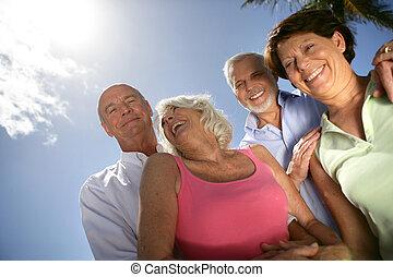 Two senior couples posing outdoors