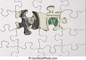 Photo of Puzzle With Money Showing Through.