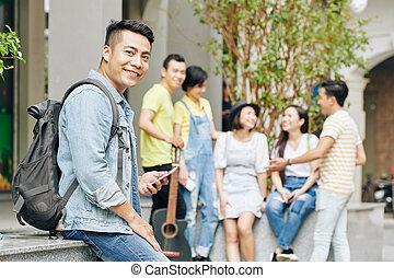 University student with smartphone