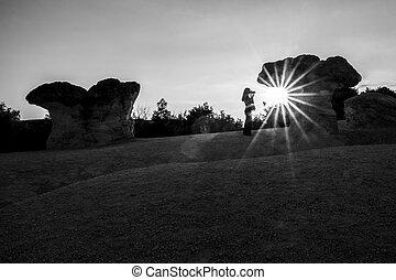 Unrecognizable female silhouette at sunset