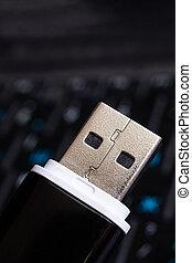 USB flashcard on laptop keyboard close up