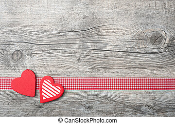 Valentines Day background with patterned hearts on old wooden