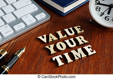 Value your time from wooden letters.