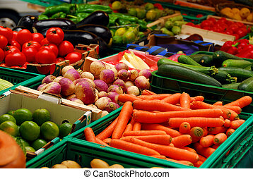 Fresh assorted vegetables in boxes on farmer's market