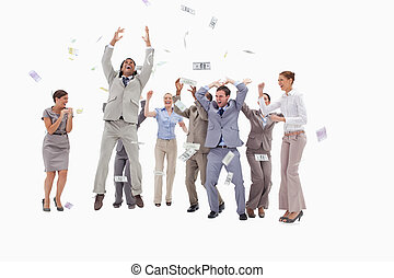 Very happy people with money falling from the sky