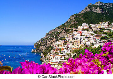 Panoramic view of Positano on the Amalfi Coast of Italy with beautiful flowers in the foreground
