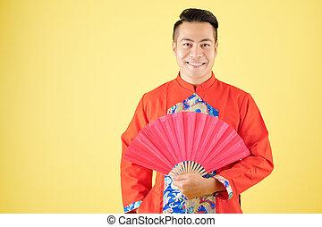Vietnamese man with paper fan