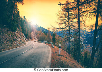 View of mountain road at sunset, Alps Switzerland