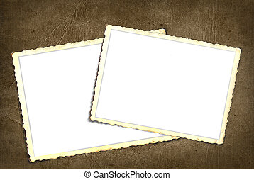 Pair of old snapshot frames on texture background.