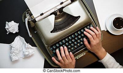 Vintage typewriter and white paper