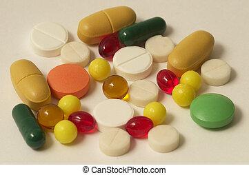 Colored glossy rounded multi vitamin pills macro shot