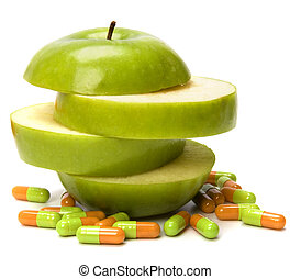 sliced apple and pills isolated on white background