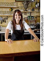 Waitress behind counter working in restaurant