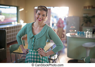Waitress standing with hands on hips